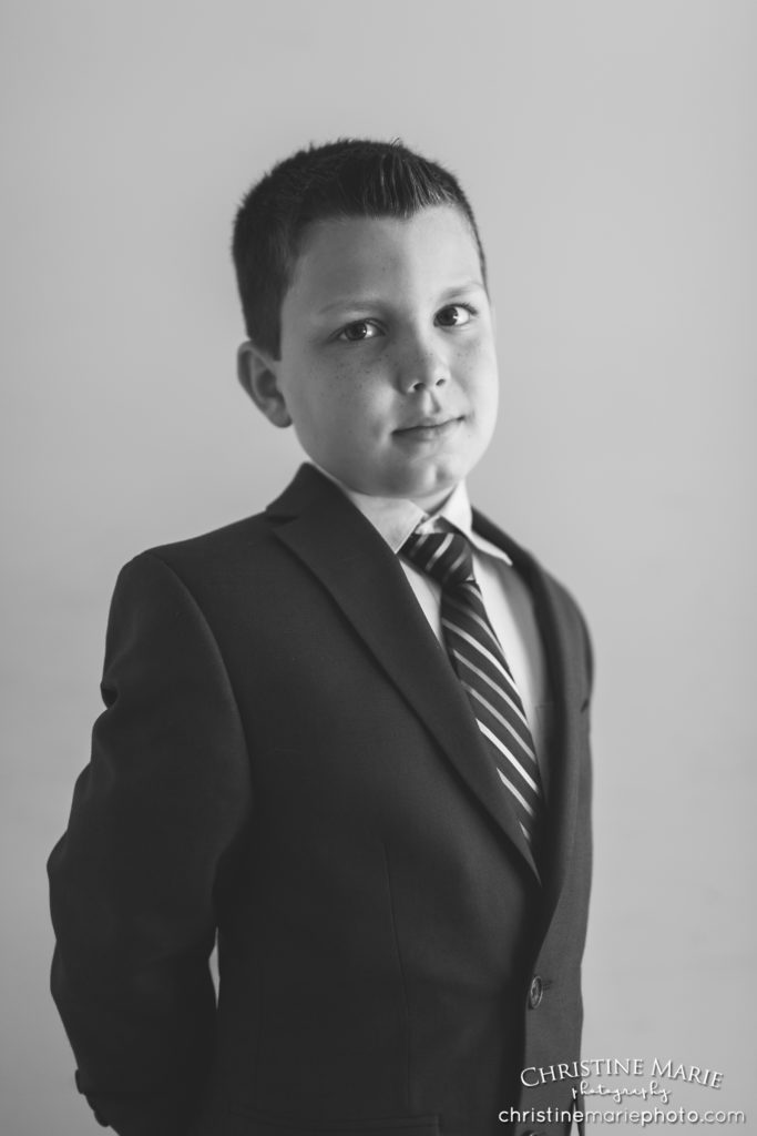 handsome boy in first holy communion portrait