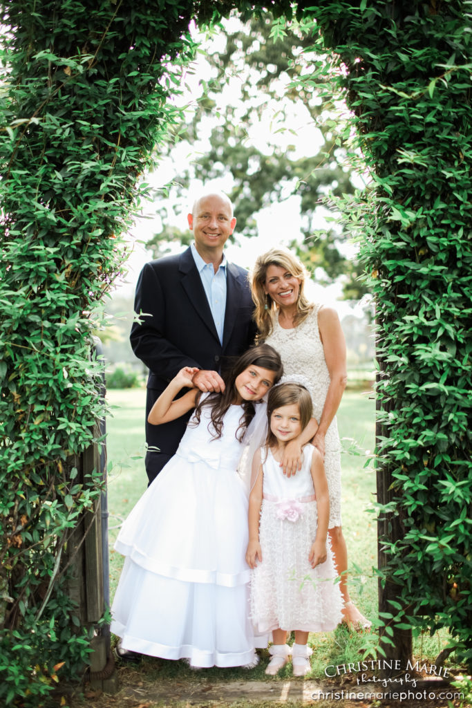family of four under an ivy arch