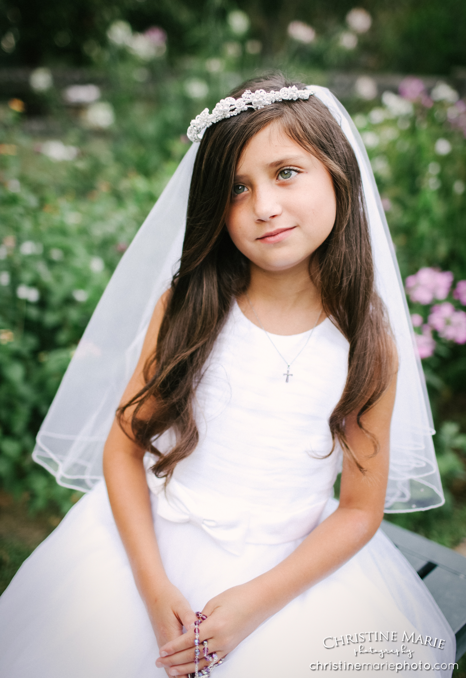 little girl with rosary in first holy communion dress