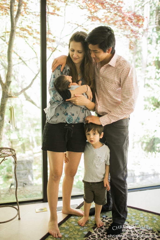 sweet mixed family with newborn baby and toddler