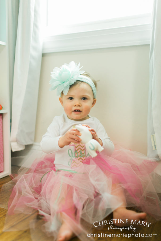 little girl with big flower headband and tutu