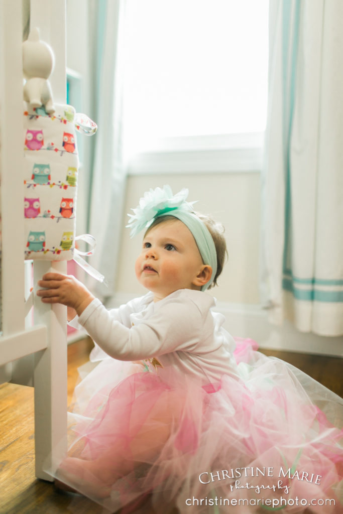 baby girl with tutu in nursery