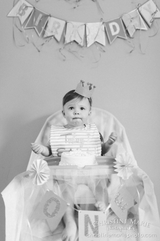 black and white first birthday party cake and crown