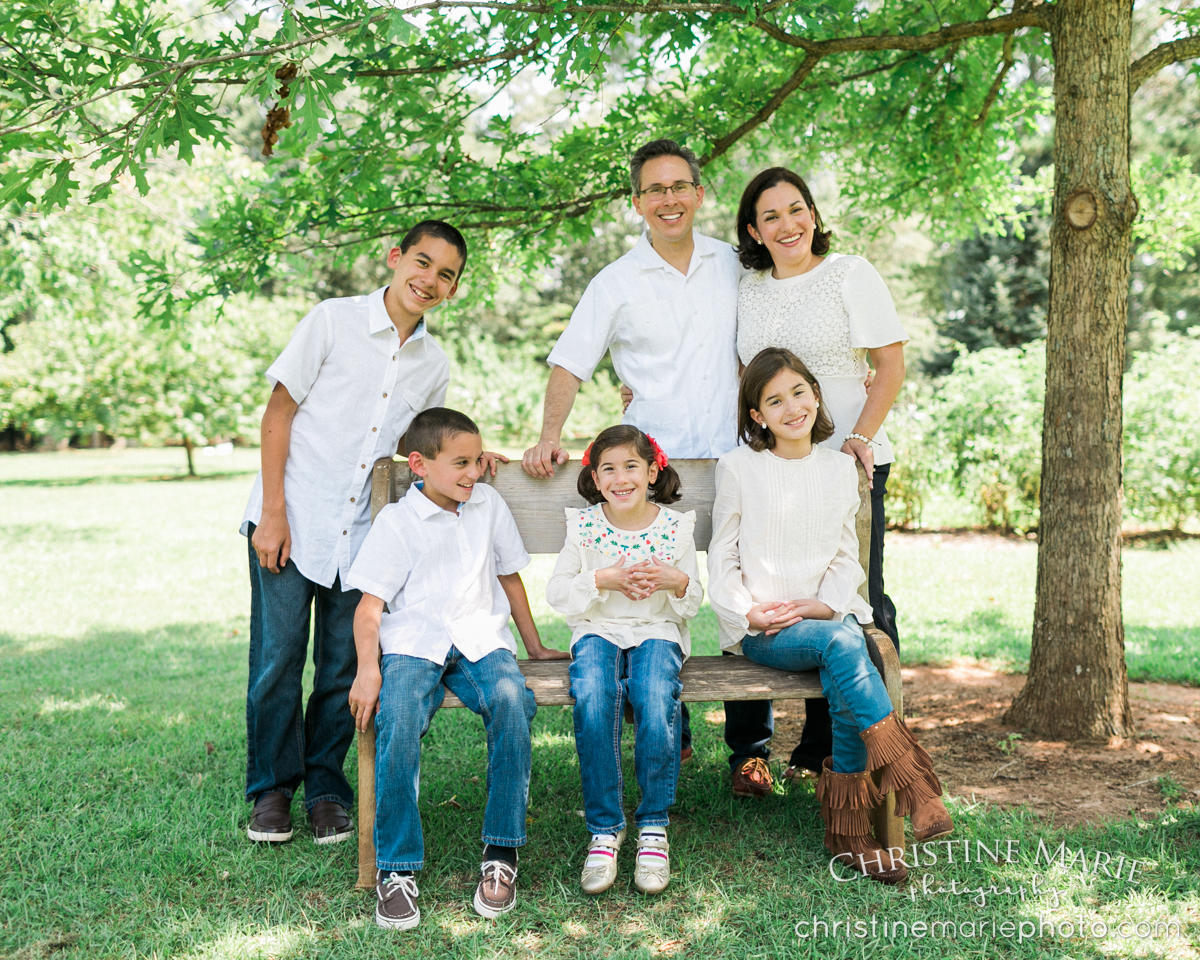 large family outdoor photo under tree
