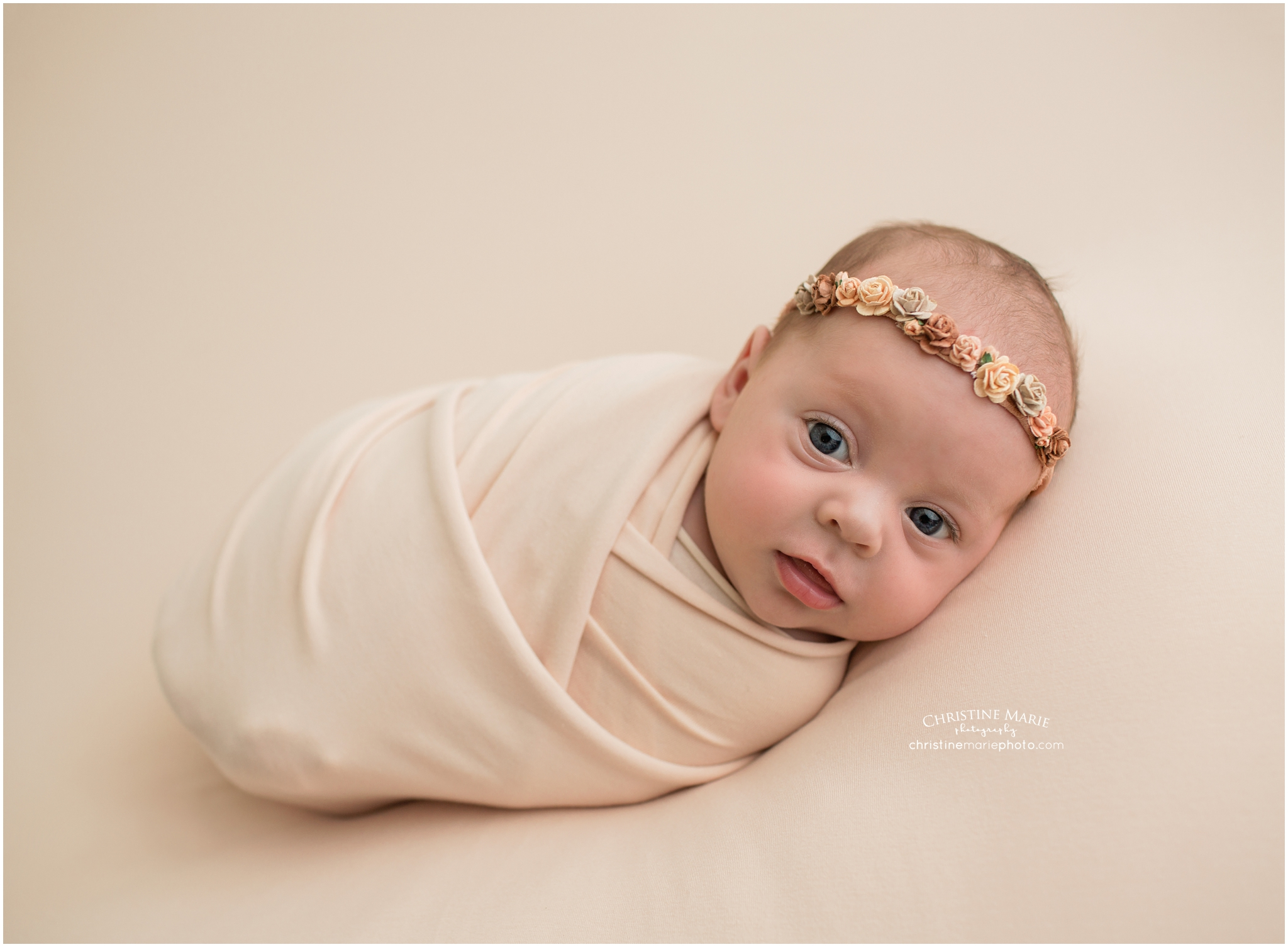 Cumming newborn photographer sweet baby girl with floral headband